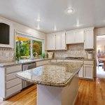 Santa Cecilia Granite with white kitchen cabinet