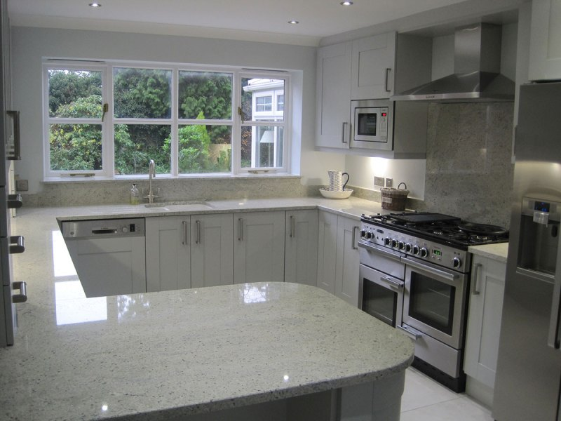 Kashmir white granite countertops pictures cost pros for Small kitchen granite countertops
