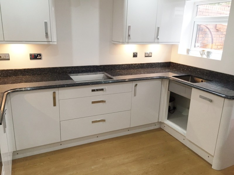 Small kitchen with blue pearl granite