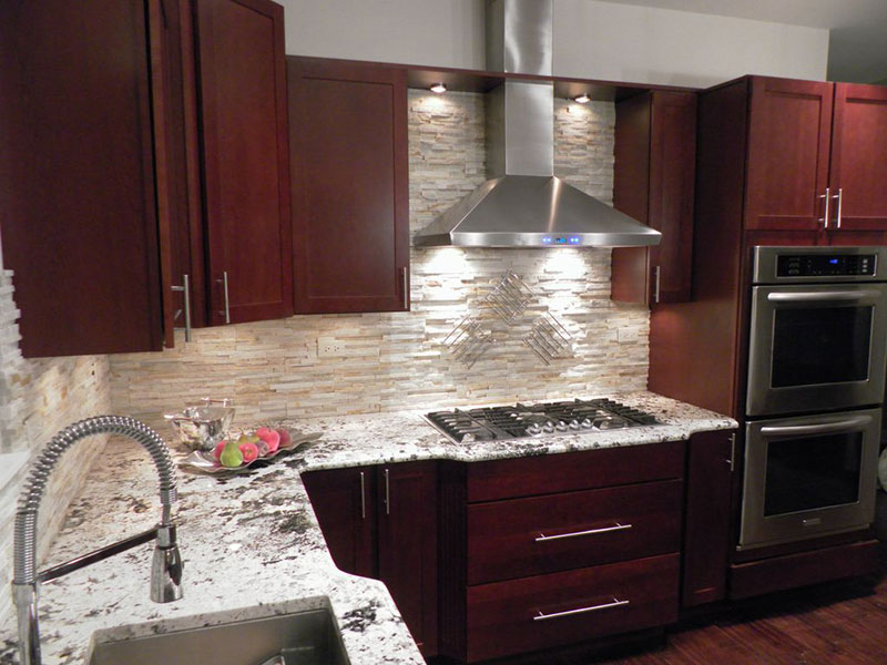 Small kitchen with bianco antico granite countertops and cherry cabinets