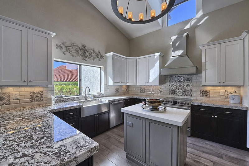 Lovely Bianco Antico Granite Countertops With Gray Cabinets