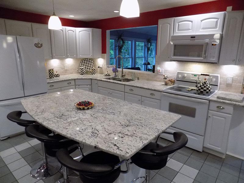 bianco romano granite countertops with white cabinets