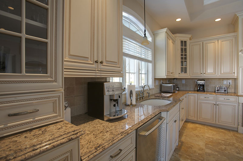Giallo ornamental granite and white cabinets