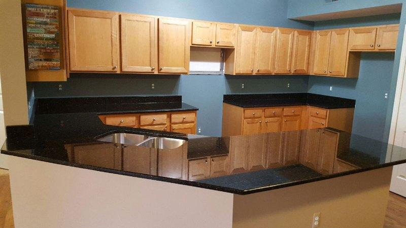 Uba tuba granite and maple cabinets