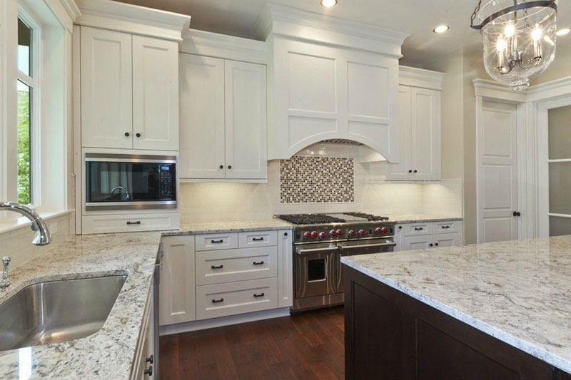 Traditional Kitchen With Bianco Antico Granite Countertops And White  Cabinets