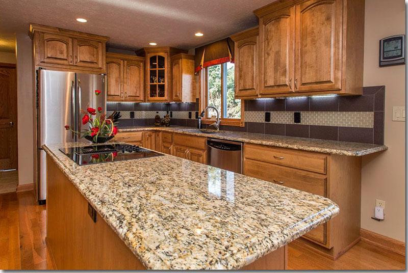 giallo ornamental granite countertops with oak cabinets