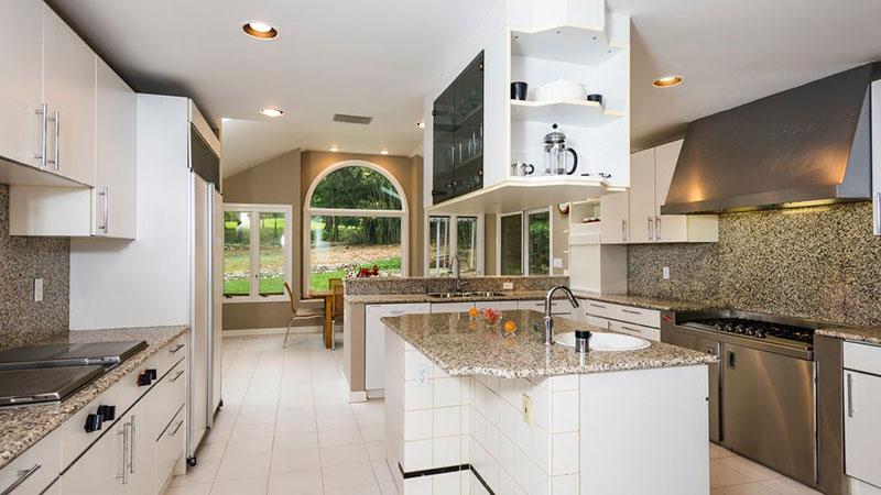 Modern white kitchens with new venetian gold granite countertops and backsplash