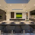 Modern kitchen with river white granite countertops