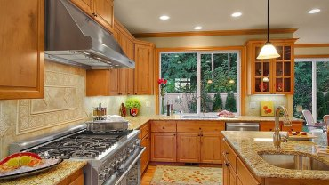 Giallo ornamental granite with honey oak cabinets