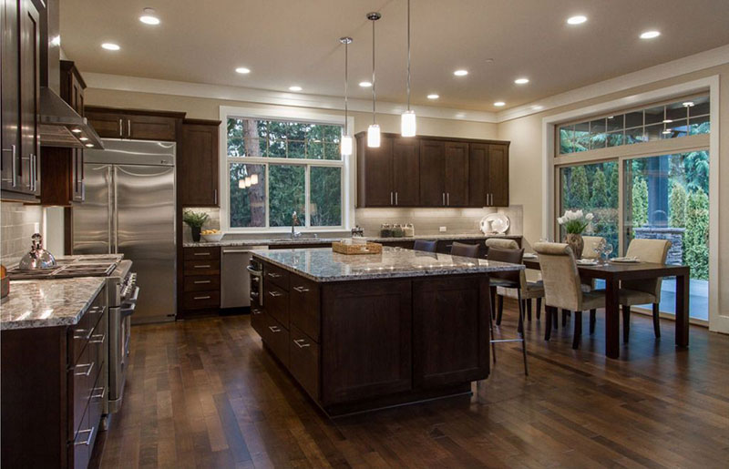 Dark kitchen cabinets with bianco romano granite