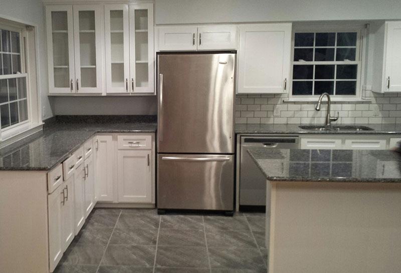 new caledonia granite with white cabinets