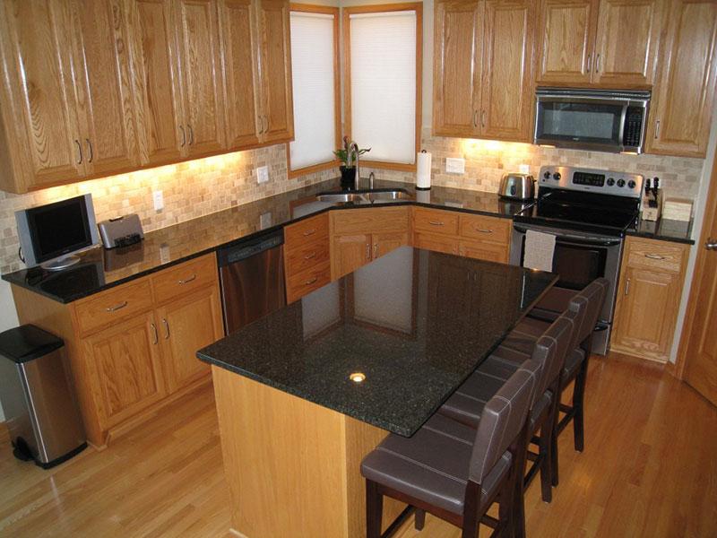 Hickory kitchen cabinets with uba tuba granite
