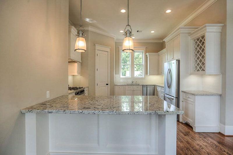Small white kitchen design with bianco antico countertops
