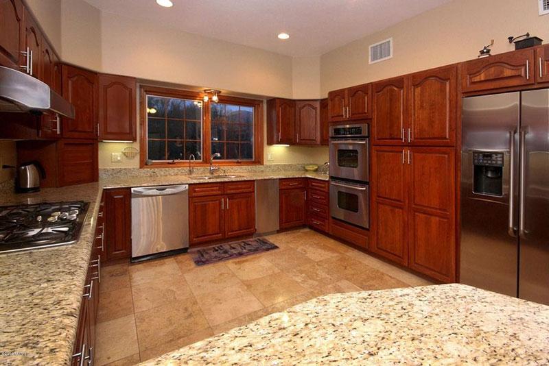 Giallo ornamental granite with brown cabinets