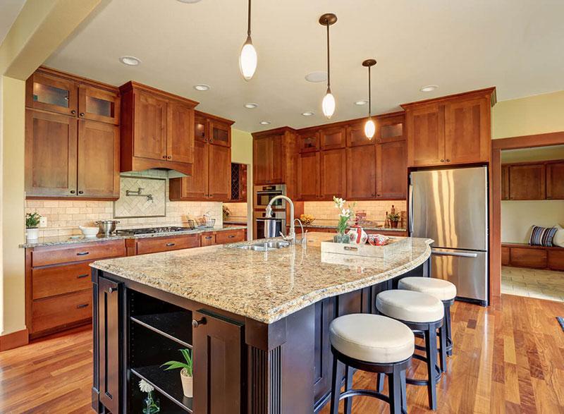 epoxy flooring kitchen solid oak island new venetian gold granite countertops - elegance