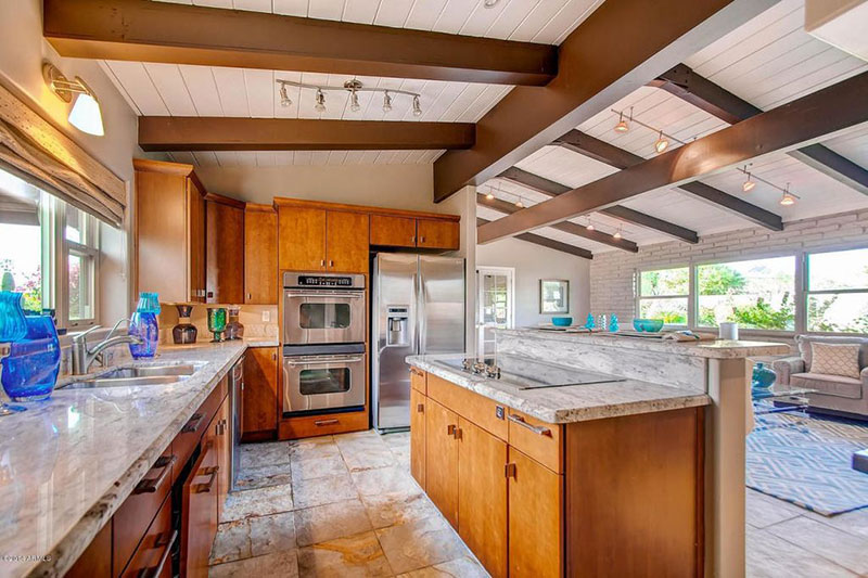 Open plan kitchen with new river white granite