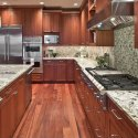 Craftsman kitchen design with bianco antico granite countertops and wood cabinets
