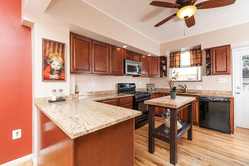 Cherry kitchen cabinets with bianco romano granite