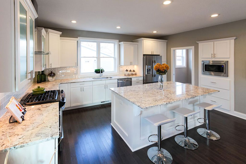 White kitchen with bianco romano granite countertops