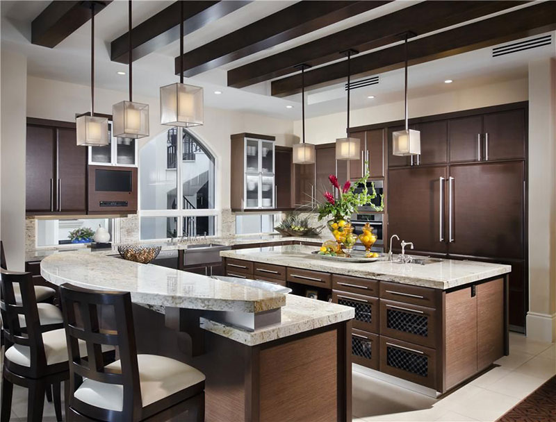 Dark brown cabinets with bianco romano granite