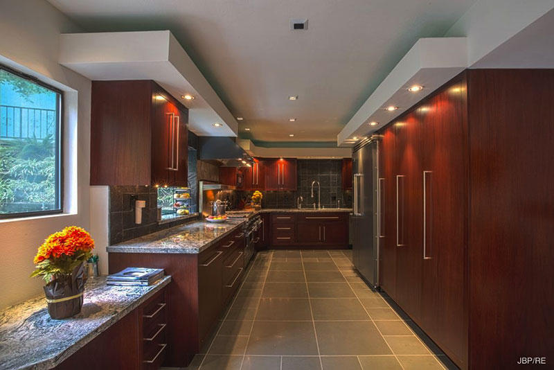 Modern kitchen with bianco antico granite countertops and subway tile