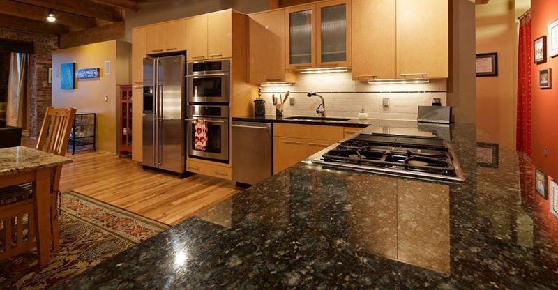 Contemporary kitchen cabinets with uba tuba granite