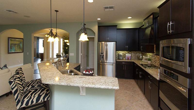 Bianco romano granite with espresso cabinets