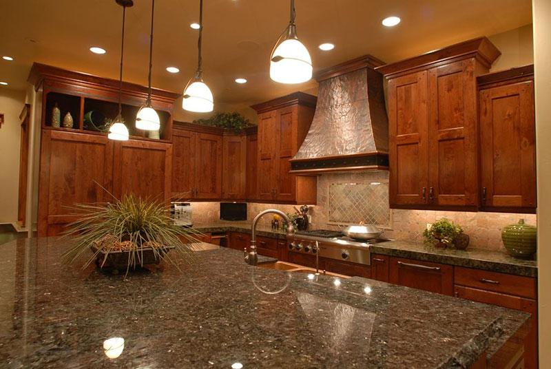 Rustic kitchen with uba tuba granite countertop
