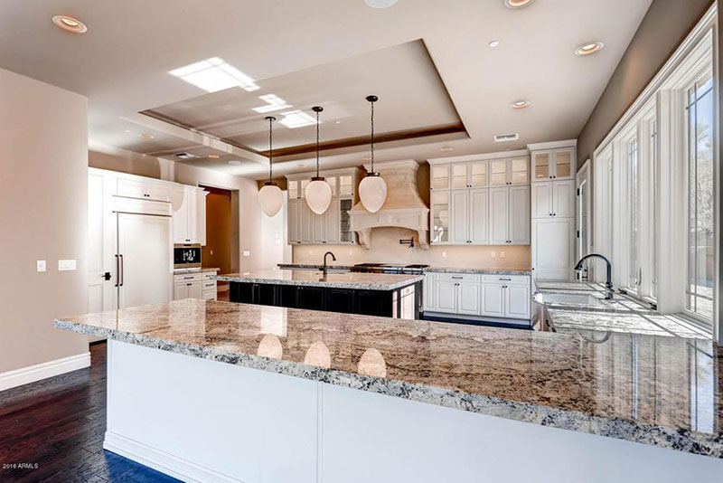 Alaska white granite countertops with white cabinets