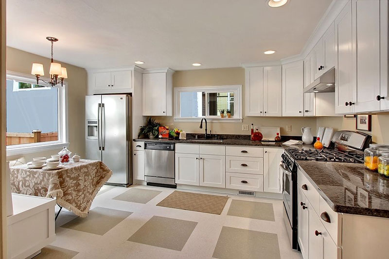 Black pearl granite in white kitchen