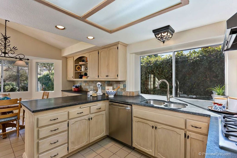 Country kitchen with black pearl granite countertops