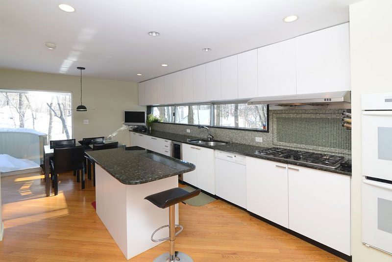 Modern white kitchen with black pearl granite countertops