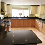 Black pearl granite with honey oak cabinets