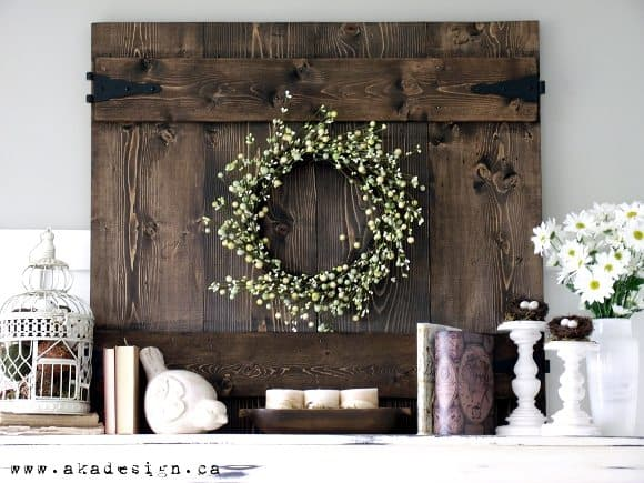 A fresh and rustic spring mantel that includes fresh flowers, birds, and a rustic fence looking piece. Inspiration for your own mantel.