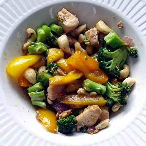 mango cashew chicken stir fry in a bowl