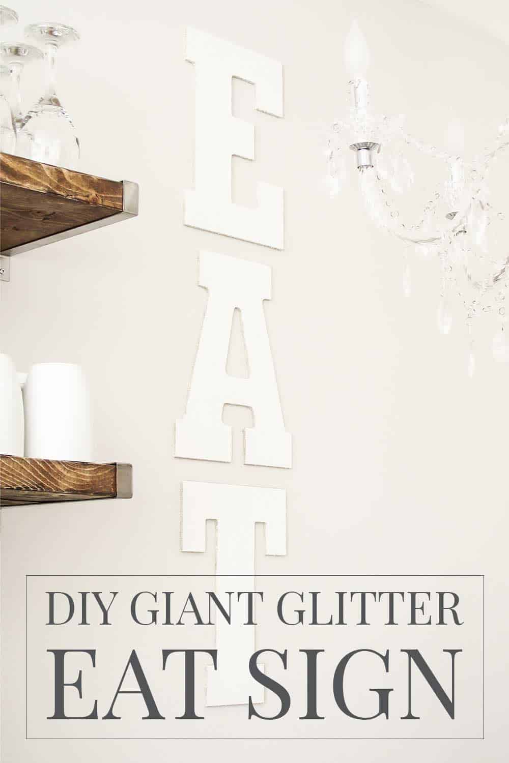 Giant glitter EAT sign on wall of kitchen.