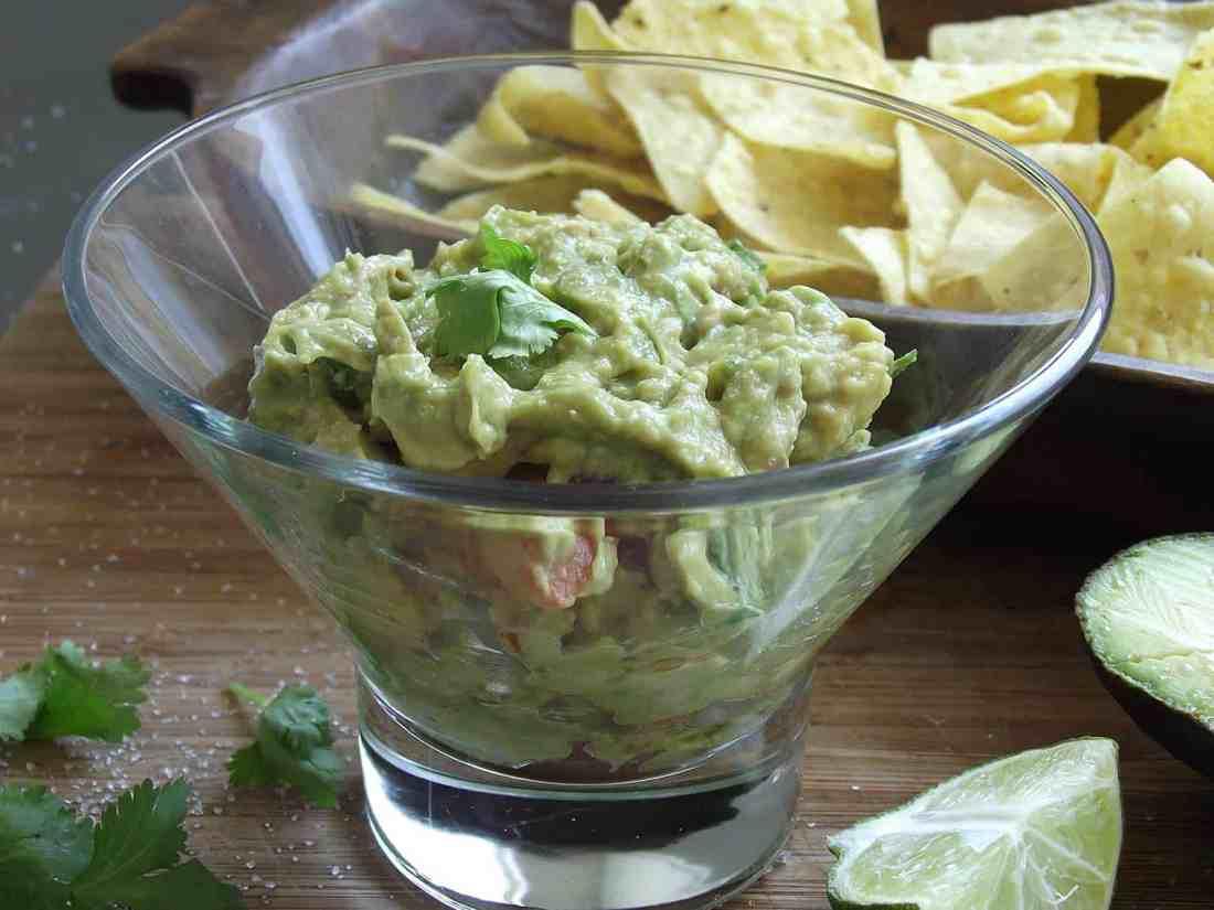guacamole in glass dish