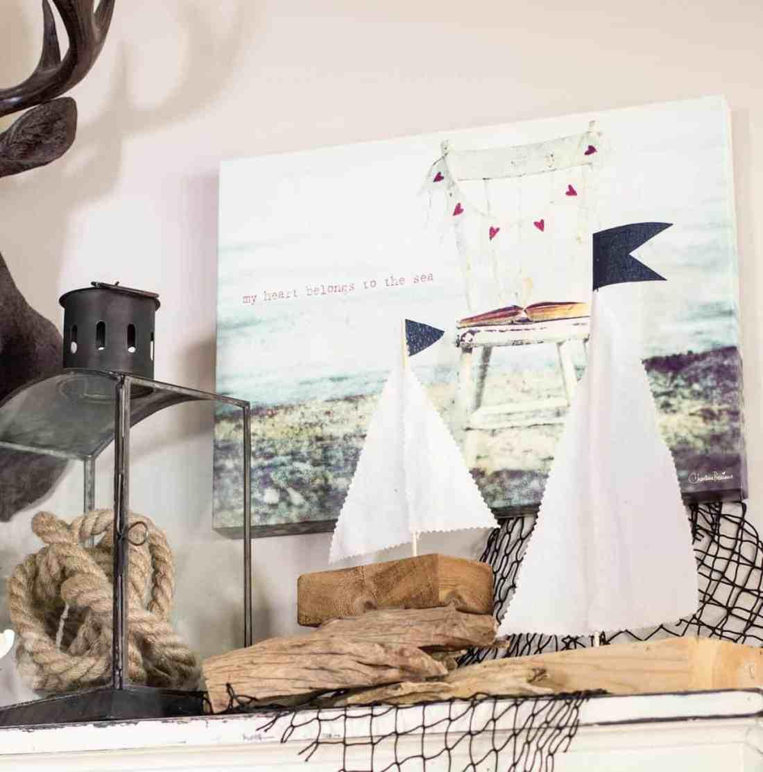DIY wood sailboats on shelf with lantern, fishing net, rope, etc as decor