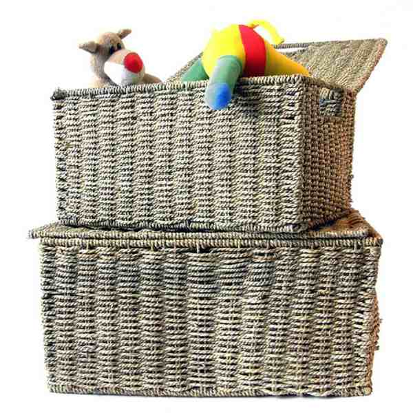 kids toys in a basket stacked on another basket
