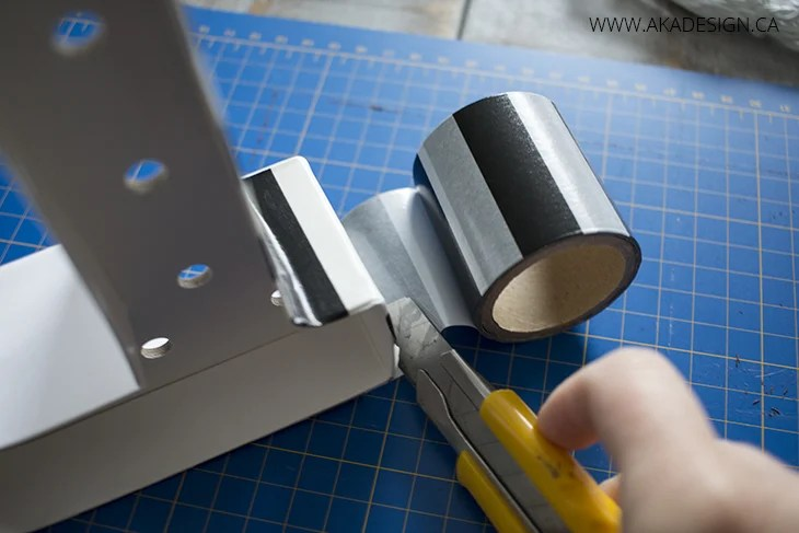cutting tape with x acto knife