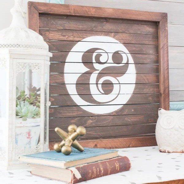 wood slat sign with ampersand painted on it 21