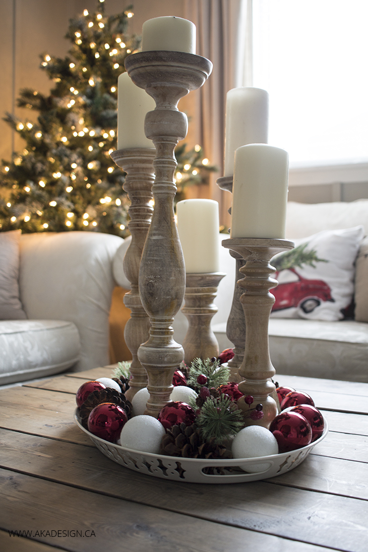 candlesticks and ornaments in a tray