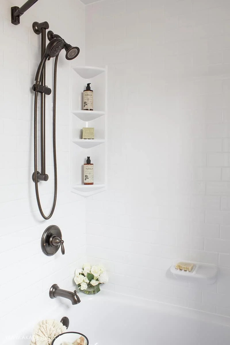 White Bath Tub and Surround Oil Rubbed Bronze Hardware
