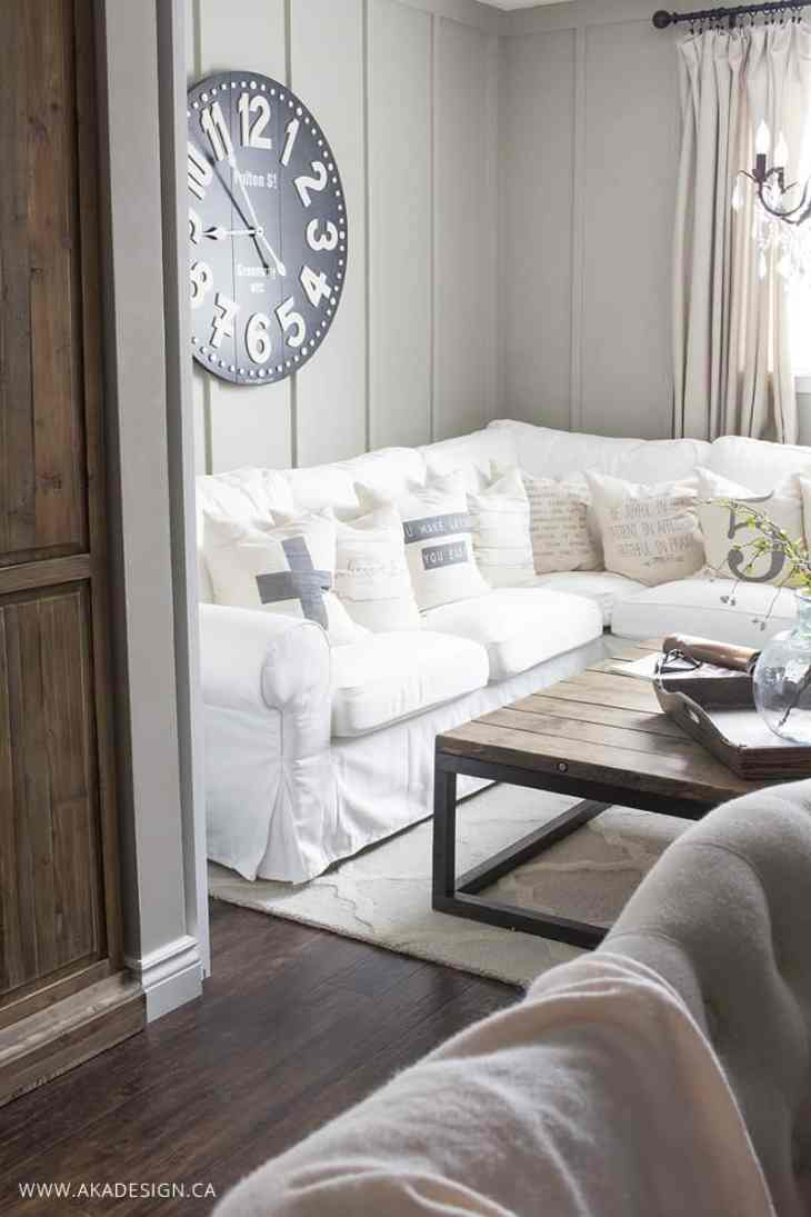 white sectional lots of pillows