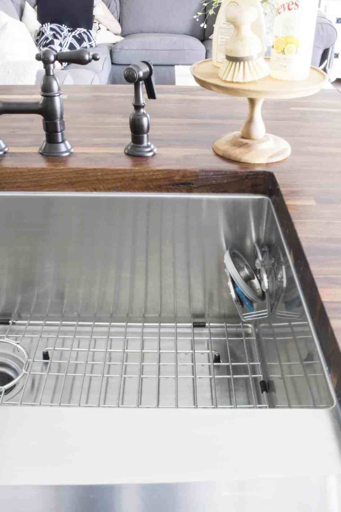 apron front stainless steel sink detail