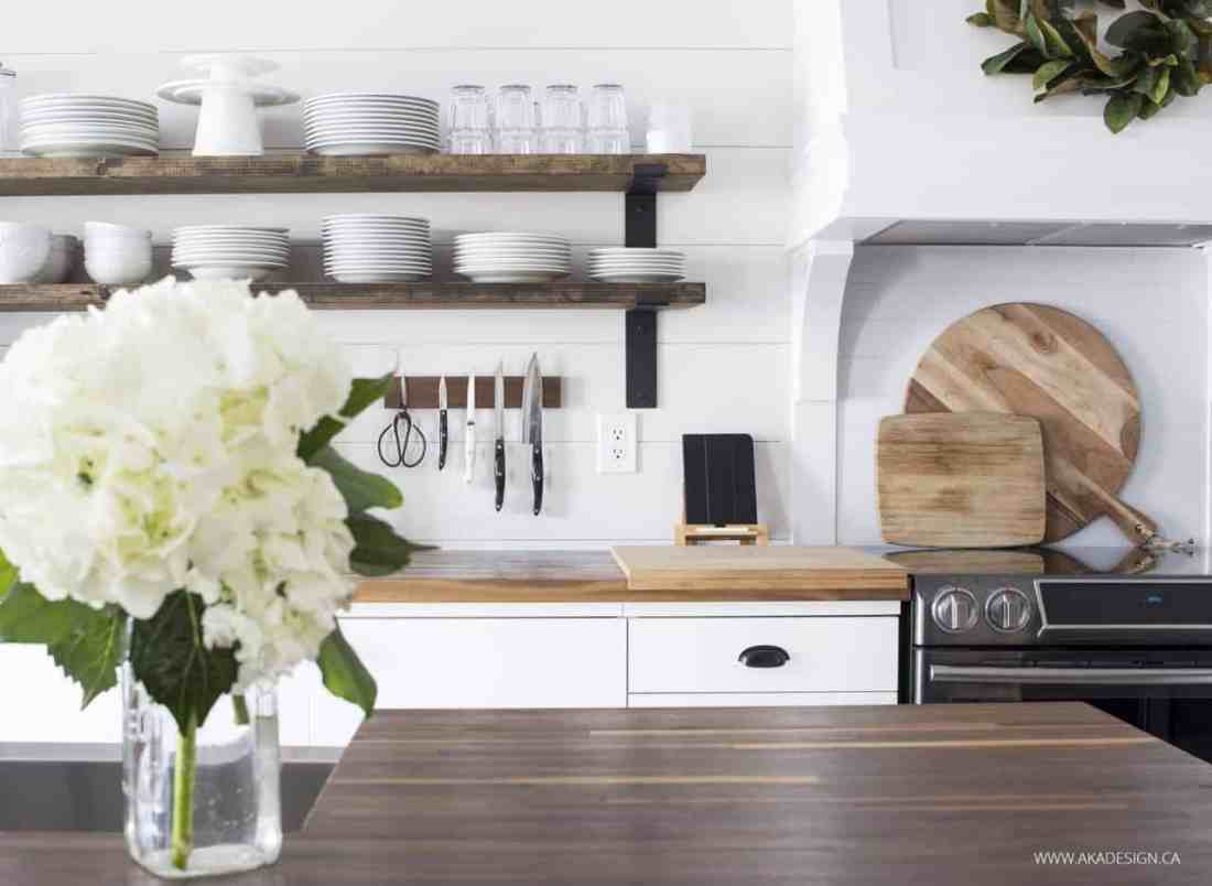 rustic wood and black bracket open kitchen shelving