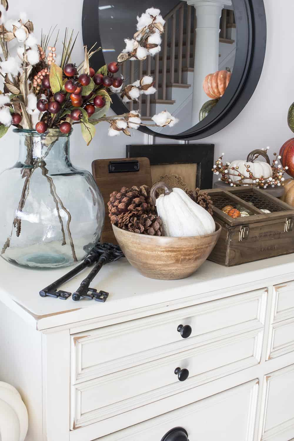 faux berries, cotten stems, wood bowls, white pumpkins