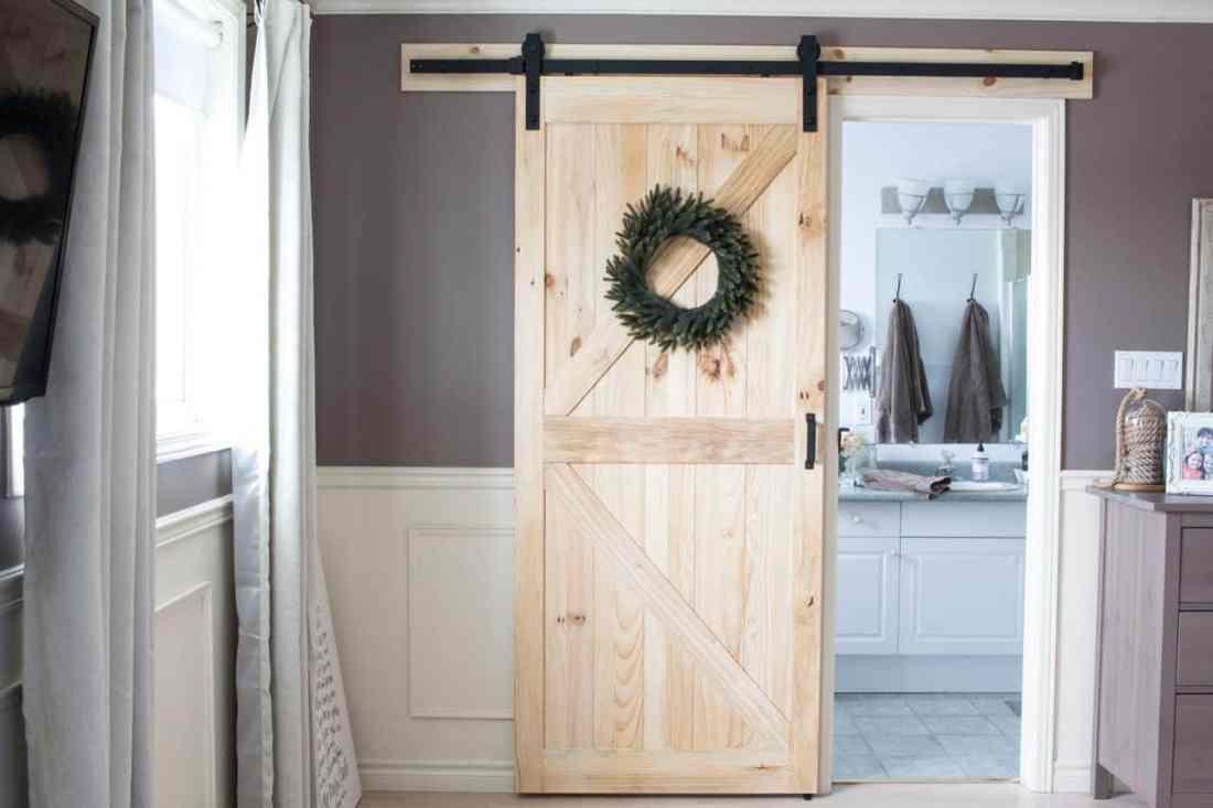Renin-Pine-Barn-door-in-master-bedroom