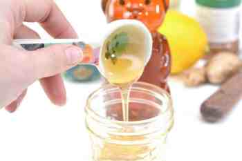 adding honey to jar for homemade cough syrup
