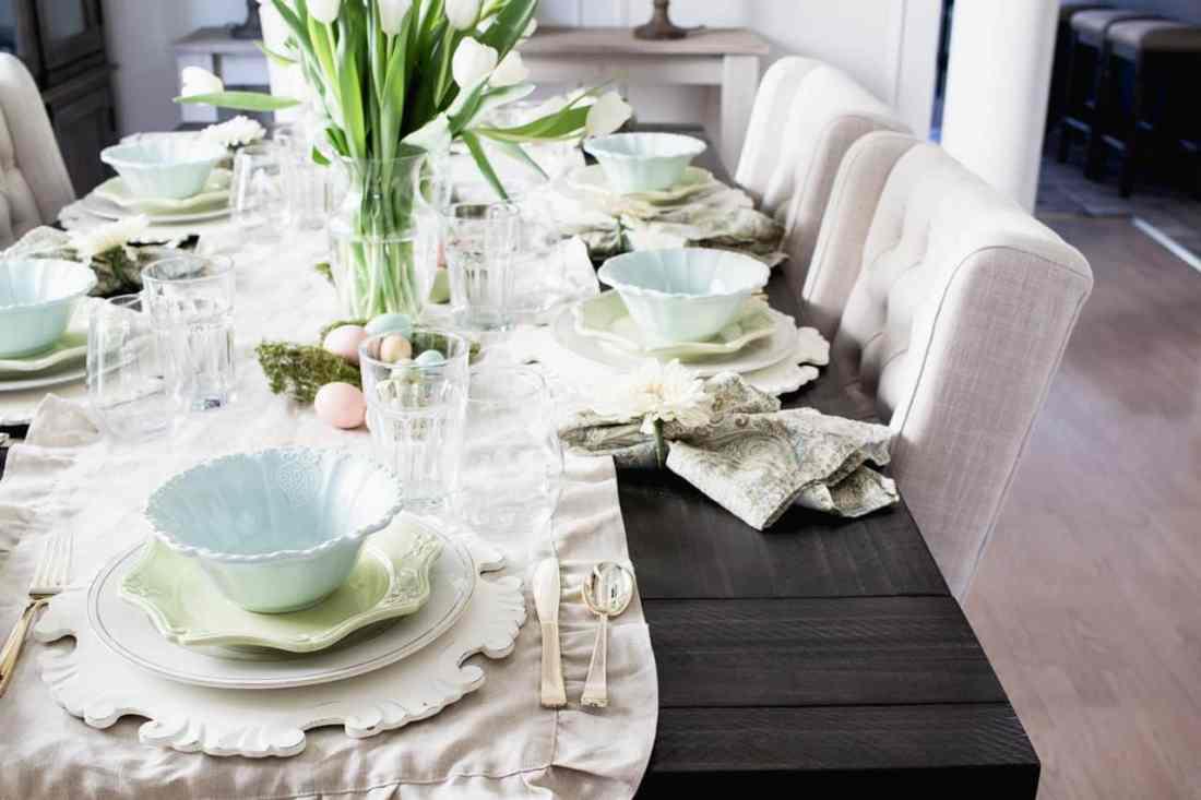 dark table, linen runner, pastel dishes